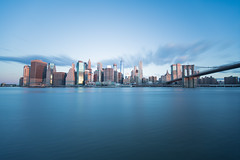 Blue Morning (Rudy Malmquist) Tags: nyc new york city skyline manhattan big apple sunshine sun sky east river water reflection lone exposure nd stopper brooklyn bridge dumbo