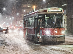 HOLD THE DOOR! (Adam Klekotka) Tags: toronto ontario canada city snow snowto trolley streetcar tram coach bus ttc snowing white night car street streetphoto architecture outdoor cityscape winter human run running lights colors travel