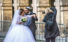 wedding photographer-2 (albyn.davis) Tags: people wedding bride photographer street paris france europe gown white dress fashion arches groom romance couple action kiss kissing
