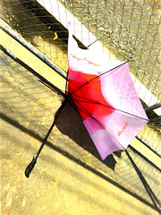 Broken Ribs (Steve Taylor (Photography)) Tags: anthonyharper umbrella broken smashed art digital fence chainlink pink red yellow brown white newzealand nz southisland canterbury christchurch cbd city shadow handle