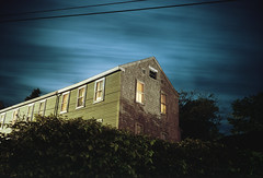 (patrickjoust) Tags: lubec maine house vines night light glow windows lookingup fujicagw690 kodakportra160 6x9 medium format 120 rangefinder 90mm f35 fujinon lens cable release tripod long exposure c41 manual focus analog mechanical patrick joust patrickjoust usa us united states north america estados unidos new england me
