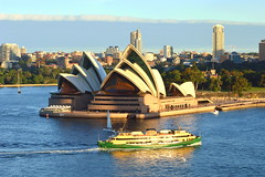 """Sydney Opera House and Harbour with ferry """"Freshwater"""" passing in late dusk on sunset - Autumn 2017 (nicephotog) Tags: sydney nsw opera building architecture icon harbour seaside water operahouse afternoon dusk evening city urban scenery view ferry boat skyscraper suburban highrise island"""