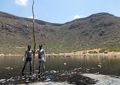 Volcano crater where Borana tribe men dive to collect salt, Oromia, El Sod, Ethiopia (Eric Lafforgue) Tags: adultsonly africa african blackpeople borana caldera colourpicture country crater danger dangerous day developingcountry elsod ethiopia ethiopia0317028 ethiopian extinctvolcano fulllenght geographic geography hardwork horizontal hornofafrica lake landscape men menonly naturalphenomenon oromia oromiya oromo oromya outdoors realpeople resources saline salt saltlake sod stick tribe twopeople volcanic volcano water workers
