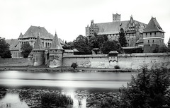 Malbork Castle at the Nogat (VandenBerge Photography (this week mostly absent)) Tags: lonelyplanet le longexposure blackandwhite historical medieval malbork malborkcastle poland canon castle ancienttown water river rivernogat żuławywiślane pommern europe