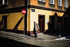 yellow fellow (ewitsoe) Tags: building man crossing street city erikwitsoe ewitsoe canon urban olderman cross caution poznan poland spring polska gentleman klasztorna architecture monring sun sunny morning