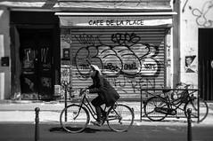 Café de la Place (GLVF) Tags: cafédelaplace café place ruesaintmaur paris xie arrondissement nordest vélo cycliste bicycle parisian parisienne noirblanc noiretblanc noir blanc blackandwhite black white slrmagic mélenchon campagne campaign politics tag graffiti rideau bar street