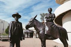 scottsdale, az (jayelyse) Tags: travel scottsdale arizona man wife bronze statue horse street art