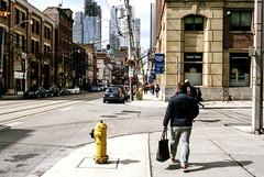 Walking With Purpose on King (Bill Smith1) Tags: agfavista400 believeinfilm billsmithsphotography heyfsc nikkormatel toronto nikkoro35f2lens