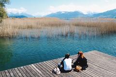 Afternoon lake gossip (nan.li) Tags: chatting afternoon reed bulrush landscape gossip girls lake