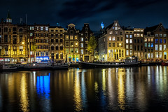 Amsterdam Amstel night reflections (PaulHoo) Tags: amsterdam city holland netherlands urban nikon d700 2017 wideangle night evening neon reflection architecture amstel river vibrant color sky clouds light illuminated illumination blue