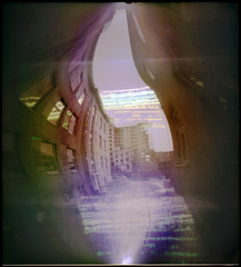 Cosmic City (batuda) Tags: pinhole obscura stenope lochkamera analog analogue can cylindrical horizontal beer beercan 16x18 wide wideangle undeveloped sun solargraph solargraphy solarigraphy solarigrafia solar solarpath track trail arch epson 4490photo color colour toned town city cityscape architecture building house window windows reflection distortion sky lsmu respublika hotel demolition spring kaunas lithuania lietuva