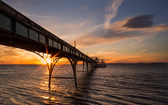 Clevedon Pier (Daniel Borg) Tags: 12mm blue calm camera clevedon clevedonpier clouds colours danielborg em5 glow gold light micro43rds omd oly olympus orange other peaceful pier places red refraction repetition ripples samyang12mm sea seascape sky somerset star starburst sun sunset water waves westcountry wideangle