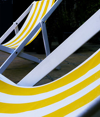 IMG_0191 lo (africanpix) Tags: digital relax outdoors photography deckchair stripes nopeople sit poolside timeout candystripe colorimage horizontalformat swinm colourimage