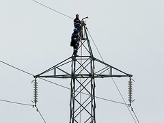 Electrifying work (Nico fotoclick) Tags: man work pylon cables electricity job