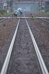 The way home in the rain (k n u l p) Tags: family blue rain crossing rail olympus 50200mm  zd   epl5