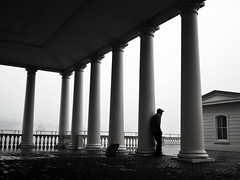 waiting out the rain (lucymagoo_images) Tags: park city urban bw man philadelphia wet water monochrome rain weather silhouette mobile architecture contrast waiting mood columns atmosphere rainy works philly fairmount android lucymagoo lucymagooimages