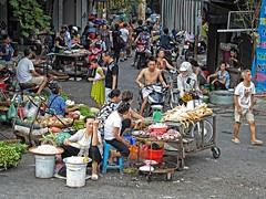 Hanoi .Street market (Marco Sarli) Tags: chicken shopping tofu motorcycle buckets hanoi streetmarket