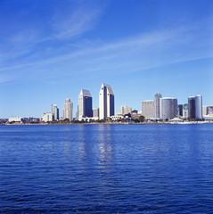 San Diego (Rafakoy) Tags: california ca city urban 120 6x6 tlr film water colors skyline mediumformat reflections square daylight cityscape minolta