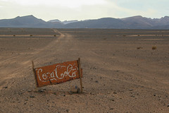 Coca-Cola irgendwo im Nirgendwo (Nico Nie) Tags: road sign desert cola nowhere ad coke advertisement schild morocco commercial marocco cocacola middle kola werbung der coca marokko mitten wste weg piste irgendwo strase nirgendwo