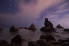 Frareseando (Toni Iglesias ) Tags: sea costa night noche mar rocks tokina nocturnas cala rocas 400d vision:sunset=0808 vision:mountain=0635 vision:sky=0966 vision:plant=0501 vision:flower=055 vision:outdoor=0715 vision:clouds=0957 vision:ocean=0693