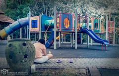 Waiting for kids to play (mtux) Tags: park playground kids mom waiting parent smcpentaxq01standardprime85mmf19