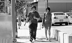 The Looking Glass (burnt dirt) Tags: houston texas downtown city town mainstreet street sidewalk streetphotography fujifilm xt1 bw blackandwhite girl woman people person animae cosplay costume uniform matsuri convention monocle magnifyingglass man couple pair walking sweaterheels shorthair glasses discoverygreen georgerbrown