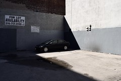 Private Parking (-»james•stave«-) Tags: newyork nyc brooklyn city urban black car parking lot parked building grey wall concrete shadow shady bright dark contrast nikon d5300