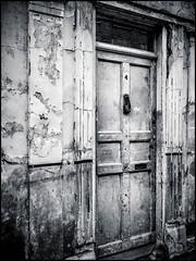 Door 4 (Darren Wilkin) Tags: mono blackandwhite door wall cracked stained dirty bricklane