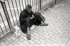 ...enjoying the moment (David Davidoff) Tags: street people life oldman human geometry sitting floor newspapers hardlife documentary urban handrolledcigarette elderly railings pavement corner