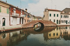 Comacchio, un ponte (amogiulietta) Tags: river delta po italy reflected bridge reflections afternoon spring sky oldbuilding architecture