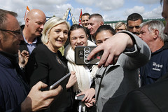 AMIENS, FRANCE - APRIL 26:  French far-right political party National Front (FN) and President French presidential election candidate, Marine Le Pen poses for selfies with strike employees of Whirlpool on April 26, 2017 in Amiens, France. France will hold