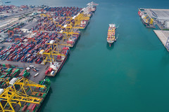 Logistic port (anekphoto) Tags: drone sea port morning logistics ship container shipping cargo import export business trade crane harbor transportation view city manufacturing dock harbour terminal sky water technology frame work construction industry structure high industrial transport global town boat machine commerce dusk thailand storage vessel delivery truck pier lift freight bangkok loading unloading shipyard freighters