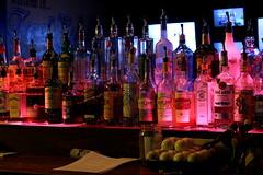 Over The Bar (micahstewart) Tags: bar grill billiards darts shuffleboard drinking alcohol hard liquor bottles beer sports
