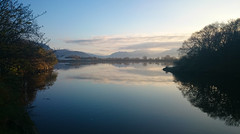 Reflections at Sunrise (uk_dreamer) Tags: landscape waterscape water reflections reflection clouds sky nature natur mirror silhouette wales cymru mountains distance sunrise ethereal morning