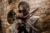 The Jazz Corner (darren.cowley) Tags: corner flickrfriday dennisrollins trombone backlit brickwork shades cool musician darrencowley pov angle
