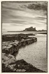 Castle Rocks Mono (david newbegin) Tags: bamburgh bamburghcastle northeastengland northumberland northsea rocks mono blackandwhite castles