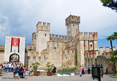 Scaliger Castle, Sirmione, Italy (GSB Photography) Tags: italy lombardy castle fortification lakegarda sirmione scaligercastle village town harbor lakeside clouds nikon d60 100v10f 250v10f aplusphoto 1500v60f