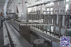 Filling capping machine-Reliance Machinery005 (Reliance Machinery Co.,Ltd) Tags: high speed rotary inline linear filler capper machine machinery equipment bottling glass bottle pet sterile pharmaceutical how make oil oral solution nasal nose case care production packing line cartoner printing labeling labler labels apply star wheel caps closing clour screw capping filling