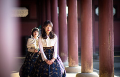 Girls in traditional hanbok | Seoul, South Korea (Faithful Freja) Tags: seoul southkorea temple shrine memorial palace colour color hanbok travelphotography traditionaldress traditional costume girl girls columns brightcolour perspective lines gyeongbokgung gyeongbokgungpalace