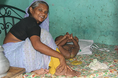 Babysitting is no fun.... (martien van asseldonk) Tags: woman baby grandmother dhaka bangladesh martienvanasseldonk