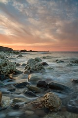 Chemical Beach (Danny Birrell) Tags: ocean longexposure light sunset red sea sky orange sun seascape colour reflection texture wet water clouds reflections landscape coast sand rocks peaceful filters tranquil slowshutterspeed tamron1750f28 canon7d hitech9ndgrad koodnd8