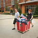 A father helps his son move into the new Wolf Ridge residence hall on Centennial Campus.