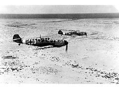 Me109Es in flight over North Africa