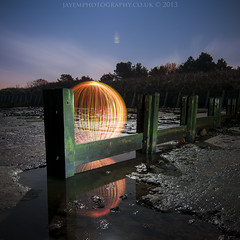 reflecting - 2 (~ jules ~) Tags: longexposure light red sky orange lightpainting reflection green beach water yellow night clouds fence ball circle globe julian sand nikon orb tokina torch sphere round jules manfrotto groynes t7 lightpaint lenser 1116mm d300s julianmarshall jayemphotographycouk julianmarshall2013