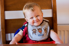 high chair scrunches (backpackphotography) Tags: baby cute girl eating era highchair backpackphotography