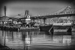 Treasure Island Barge (ronWLS) Tags: bw reflection water oakland boat blackwhite post baybridge nik barge postprocessing silverefexpro2 canonlearningcentertriptosanfrancisco