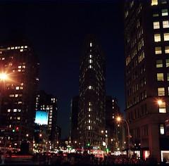Flat Iron at Night (aaronvandorn) Tags: newyorkcity longexposure nightphotography winter broadway nightscene madisonsquarepark flatironbuilding 25thstreet minoltaautocord streakedtaillights