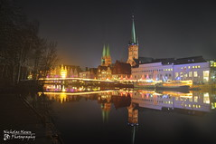 Lbeck Altstadt (mystrg) Tags: christmas city bridge winter reflection church water horizontal night buildings river germany europe market towers christmaslights lbeck altstadt oldtown lubeck