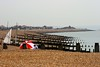Umbrella, Bournemouth beach (Davoski) Tags: umbrella shingle bournemouth groins breakwaters sail