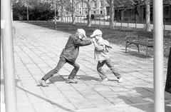 Olympus Mju II - Kid's Fight (Kojotisko) Tags: olympusmjuii mju2 bw brno czechrepublic streetphoto creativecommons